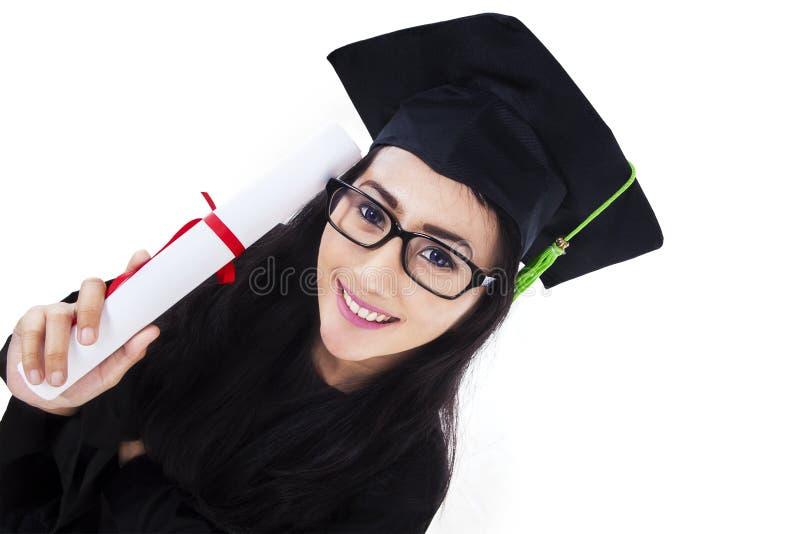 Jeune femme asiatique d'obtention du diplôme photos stock