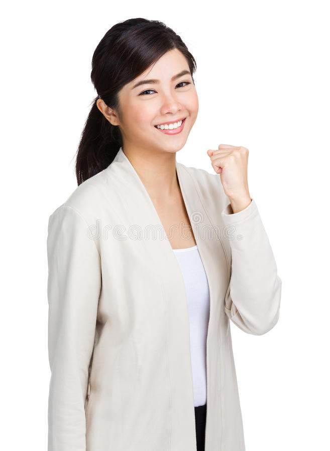 Jeune femme asiatique montrant le poing images stock