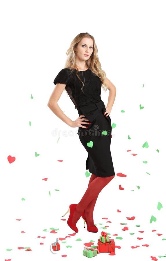 Jeune femme attirant dans la robe de soirée image libre de droits