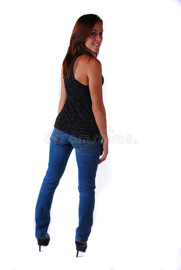 Jeune femme attirant en glaces photographie stock libre de droits