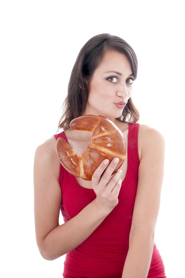 Jeune femme attirante avec le bagel photo stock