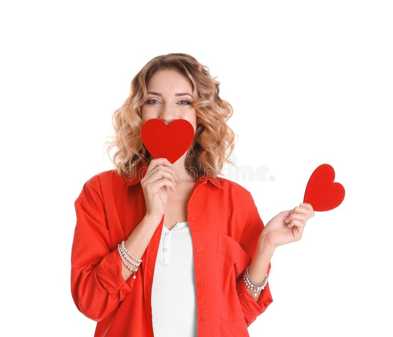 Jeune femme attirante avec les coeurs rouges images stock