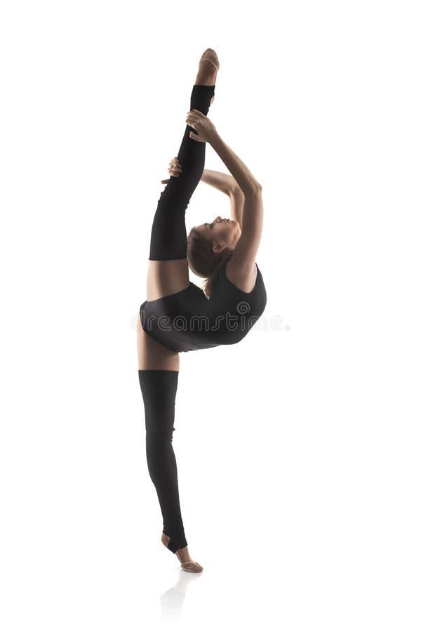 Femme dans la pose gymnastique photos stock