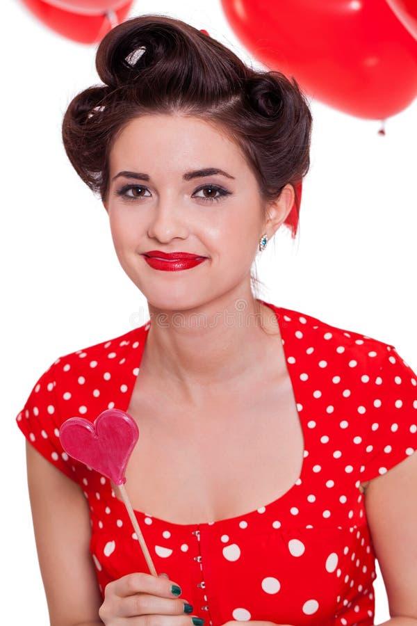 Jeune femme attirante de sourire de fille avec les lèvres rouges d'isolement photos stock