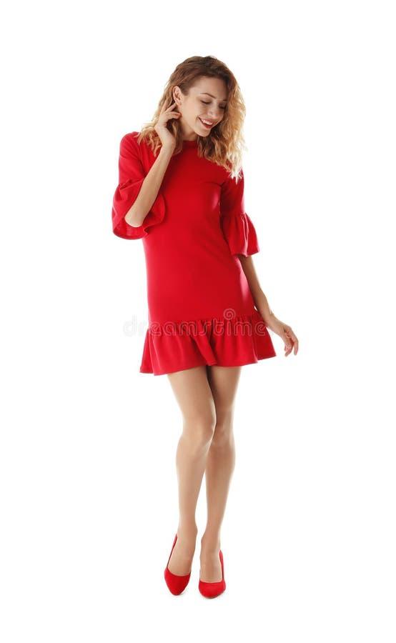 Jeune femme avec de belles longues jambes dans l'équipement élégant sur le backgroun blanc photo libre de droits