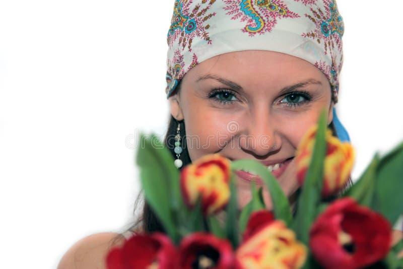 Jeune femme avec des tulipes photos libres de droits