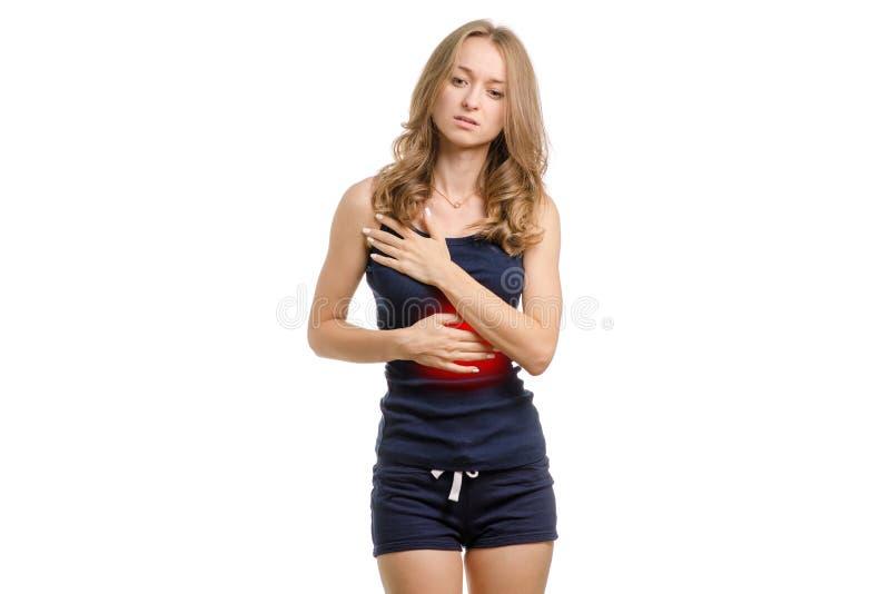 Jeune femme avec douleur abdominale photographie stock libre de droits
