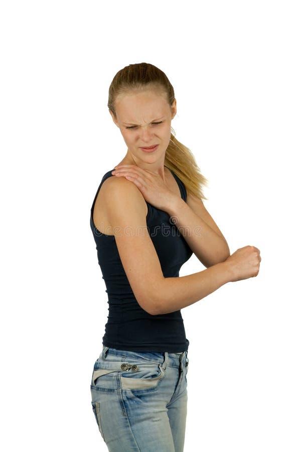 Jeune femme avec douleur d'épaule photographie stock libre de droits