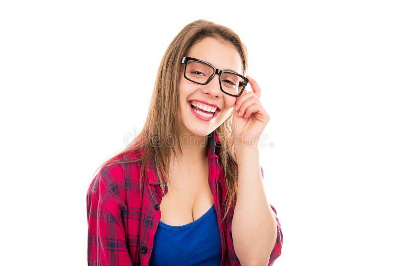 Jeune femme avec du charme dans des lunettes image stock