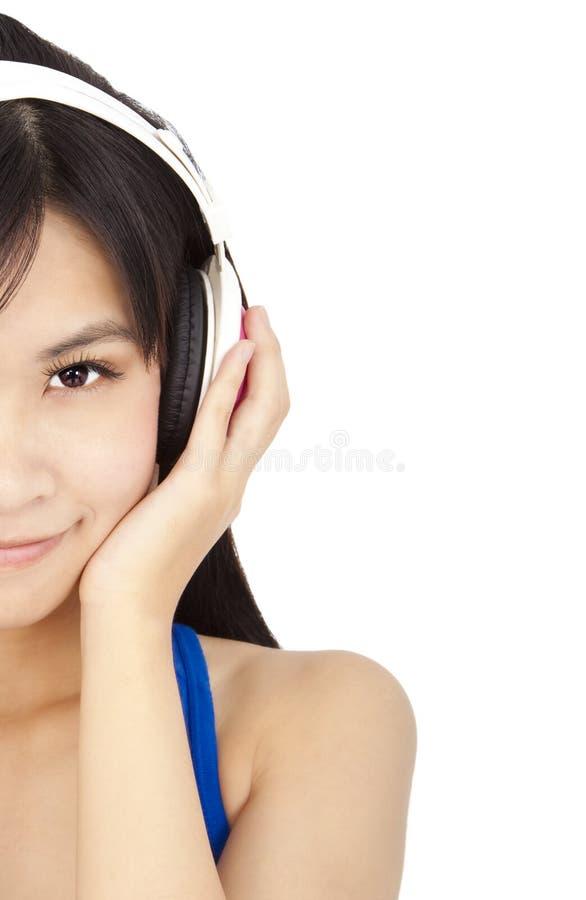 Jeune femme avec l'écouteur photos stock