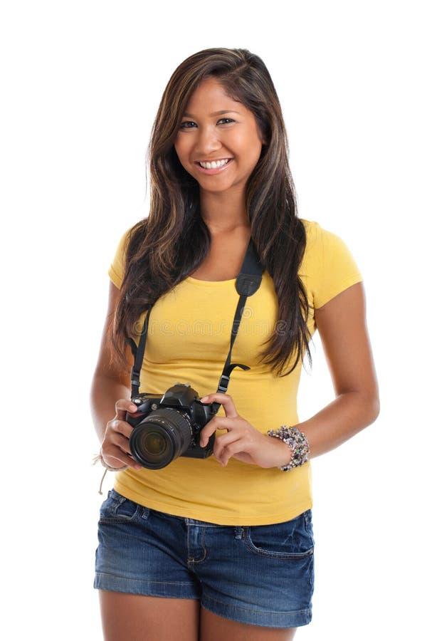 jeune femme avec l 39 appareil photo num rique photo stock image du asiatique regarder 22952986. Black Bedroom Furniture Sets. Home Design Ideas