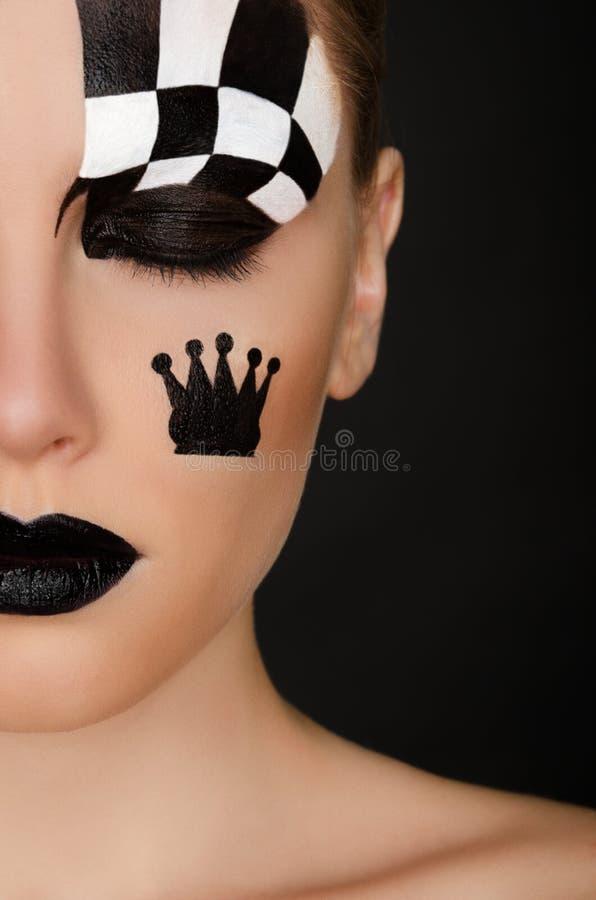 Jeune femme avec l'art noir et blanc de visage photographie stock libre de droits
