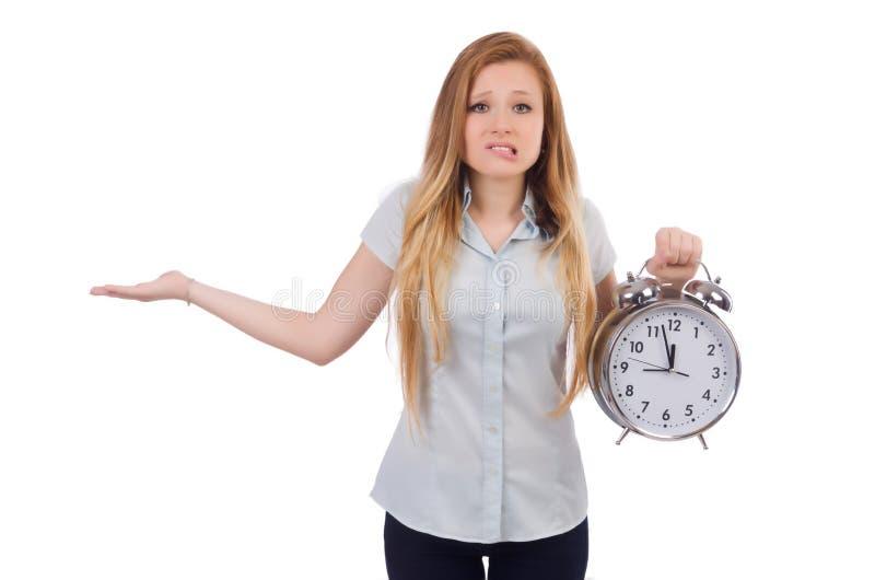 Jeune femme avec l'horloge images stock