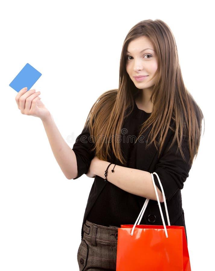 Jeune femme avec la carte de cadeau image libre de droits