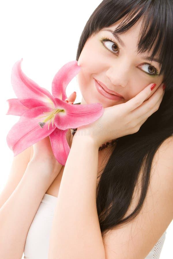 Jeune femme avec la fleur image stock