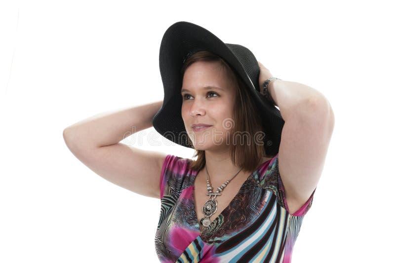 Jeune femme avec le chapeau photo stock