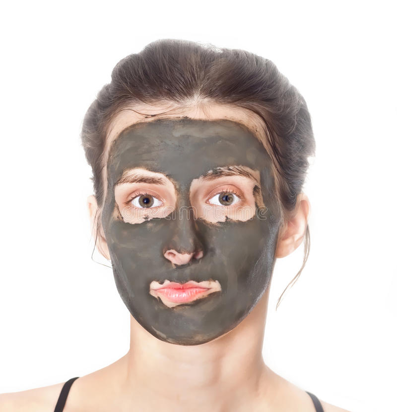 Jeune femme avec le masque facial photos libres de droits
