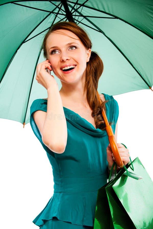 Jeune femme avec le parapluie image libre de droits