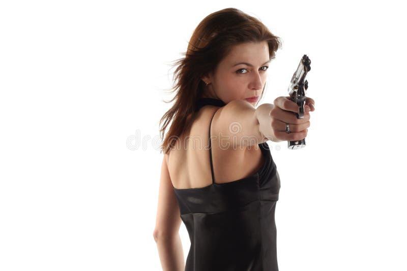 Jeune femme avec le revolver photographie stock