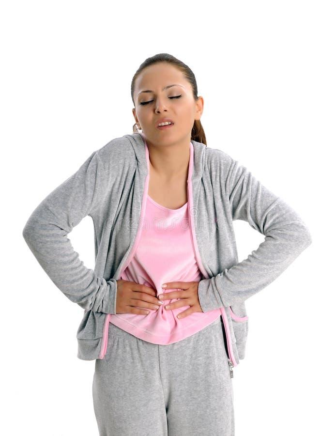 Jeune femme avec le tummyache photographie stock libre de droits