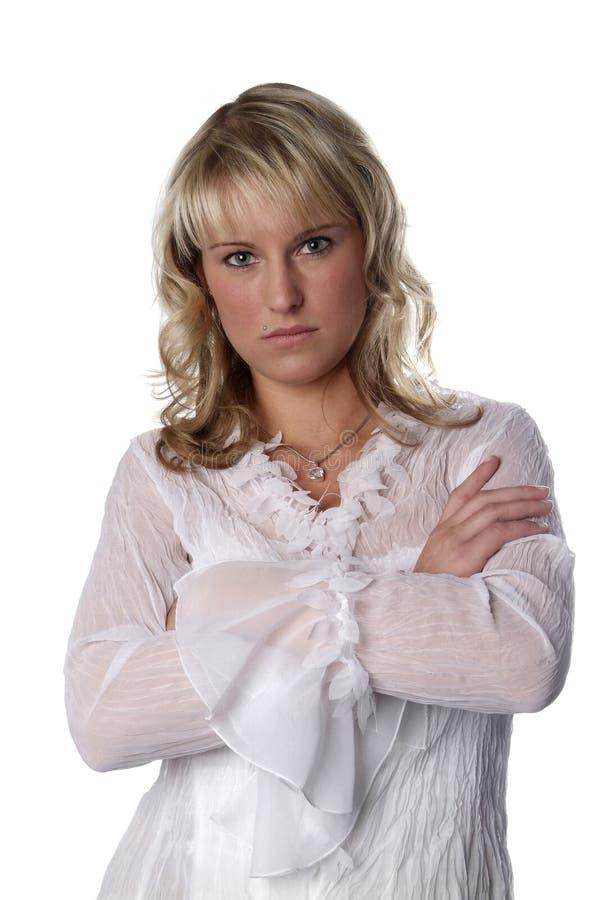 Jeune femme avec les bras pliés image libre de droits