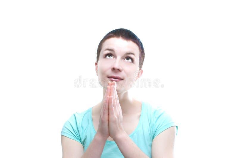 Jeune femme avec les mains pliées photographie stock