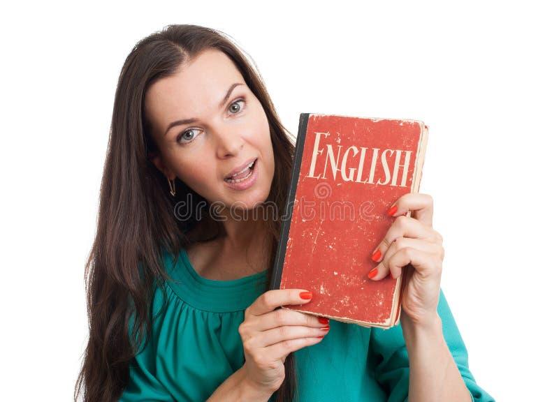 Jeune femme avec un manuel anglais photos libres de droits