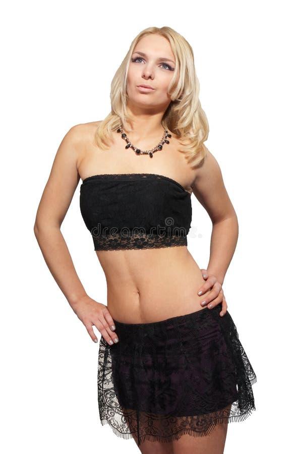 Jeune femme blond attirant dans le studio au-dessus du blanc photographie stock libre de droits