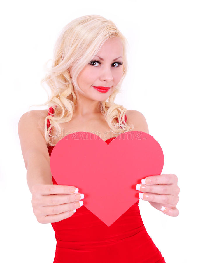 Jeune femme blonde avec le coeur de Valentine, d'isolement photos libres de droits