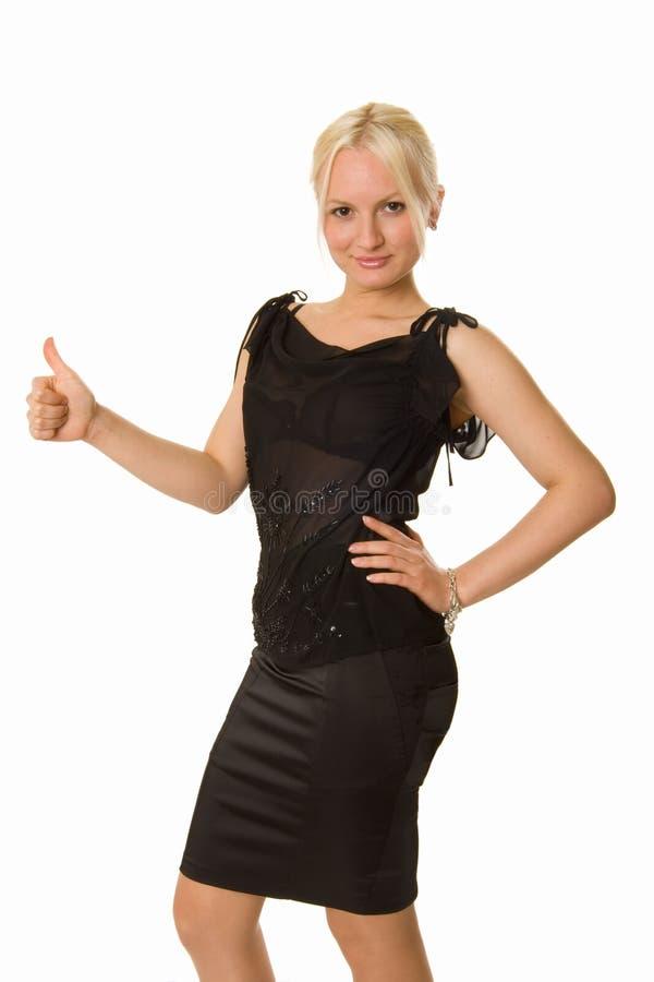 Jeune femme blonde restant avec son pouce vers le haut photos stock