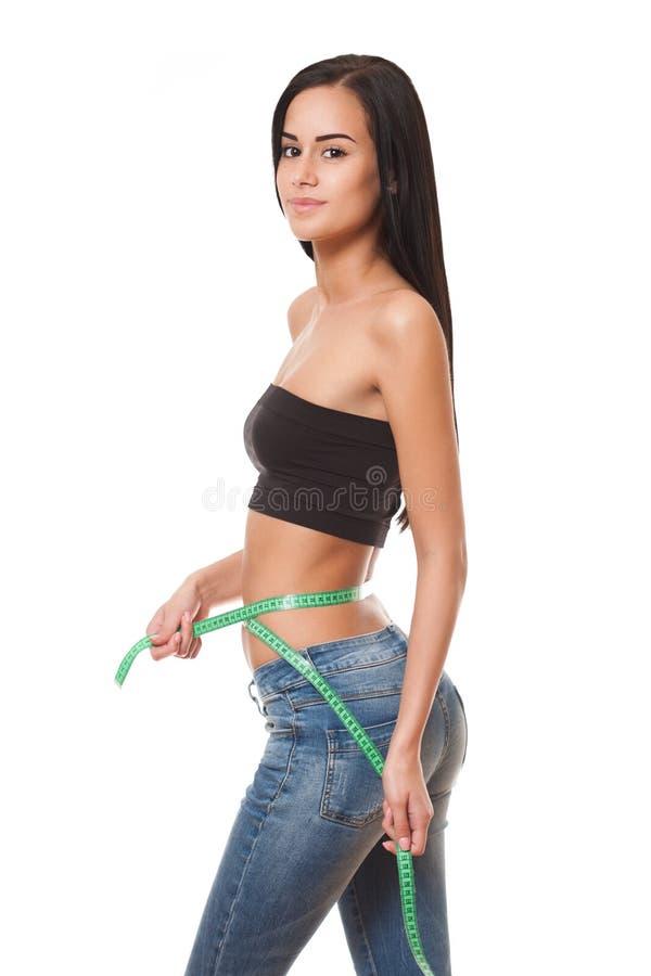 Jeune femme convenable montrant le chiffre mince photos libres de droits