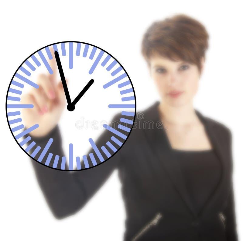 Jeune femme d'affaires avec l'horloge d'isolement images stock