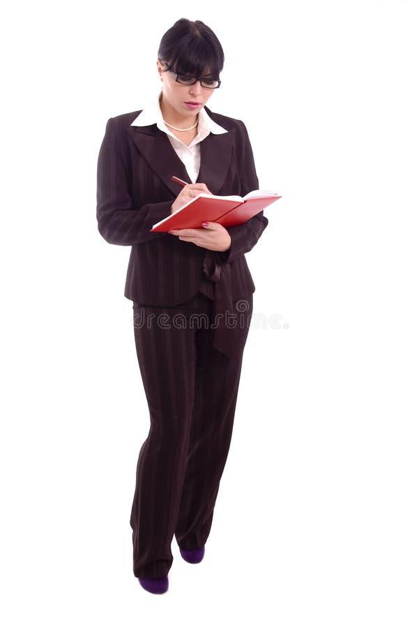 Jeune femme d'affaires avec l'ordre du jour rouge image stock