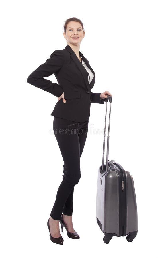 Jeune femme d'affaires avec la valise d'isolement photographie stock libre de droits