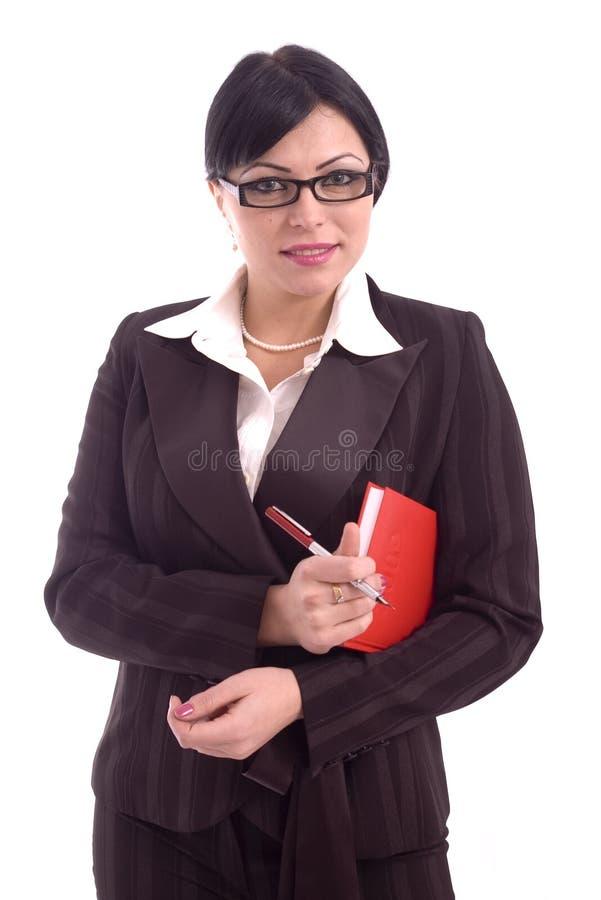 Jeune femme d'affaires avec le crayon lecteur et l'ordre du jour photographie stock