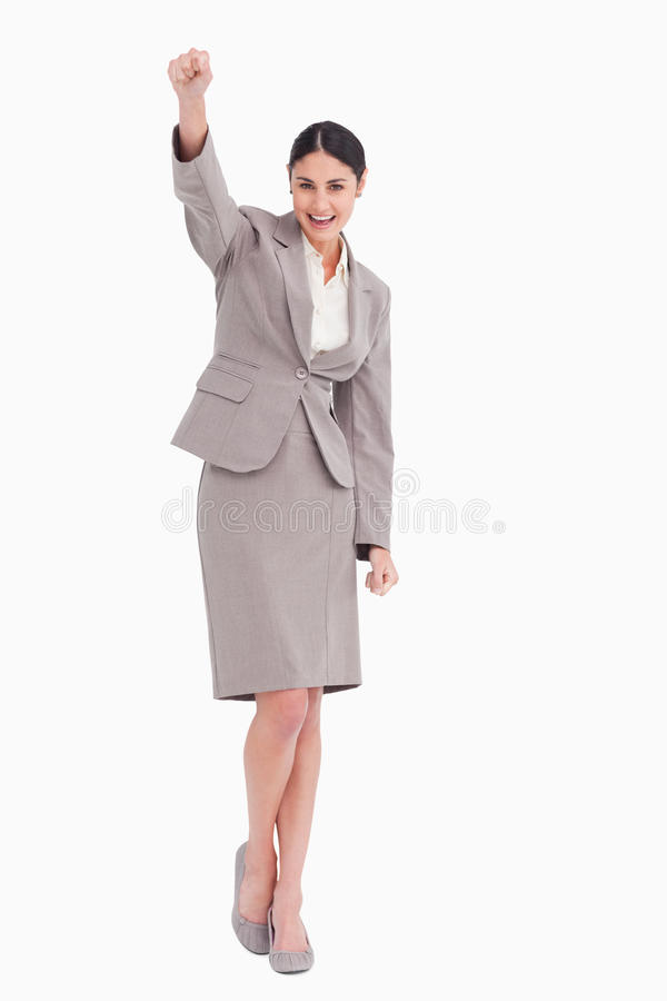 Jeune femme d'affaires célébrant la réussite photo stock