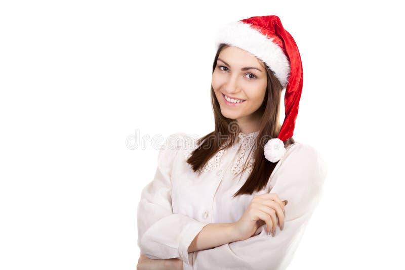 Jeune femme d'affaires dans le chapeau rouge de Santa Claus sur le fond blanc photographie stock