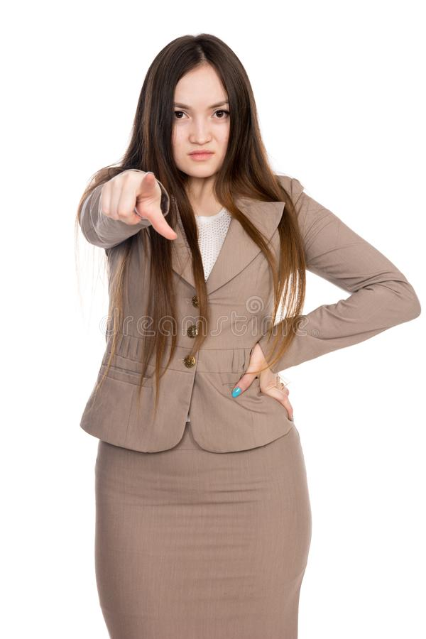 Jeune femme d'affaires dirigeant la droite de doigt d'isolement au-dessus du fond blanc photographie stock libre de droits