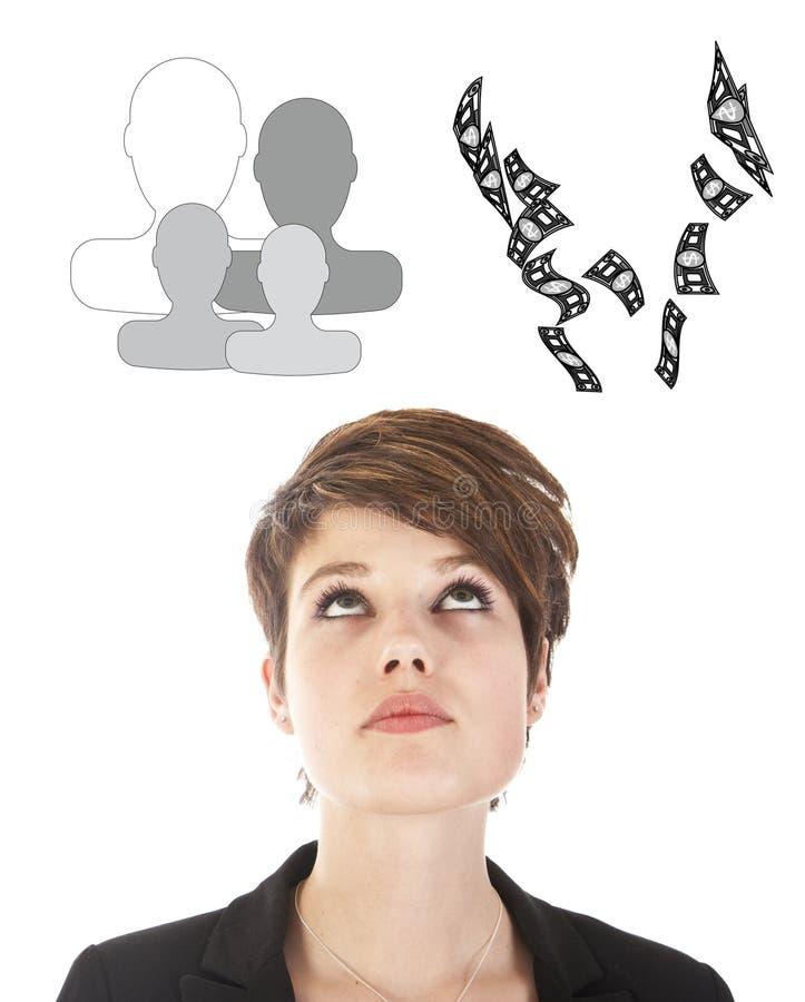 Jeune femme d'affaires faisant un choix entre la famille ou la carrière d'isolement photographie stock libre de droits