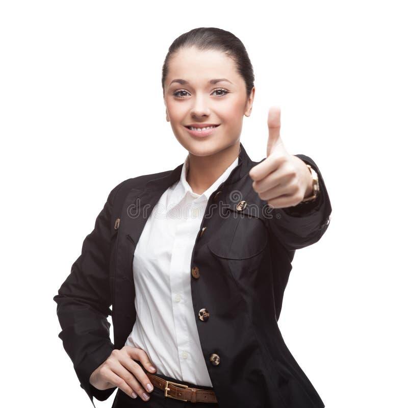 Jeune femme d'affaires gaie sur le blanc photographie stock libre de droits