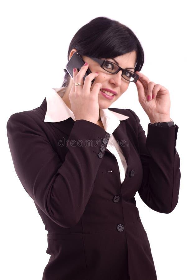 Jeune femme d'affaires parlant au téléphone photo libre de droits