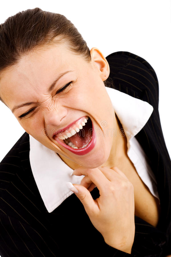 Jeune femme d'affaires riant de façon hysterique photo stock