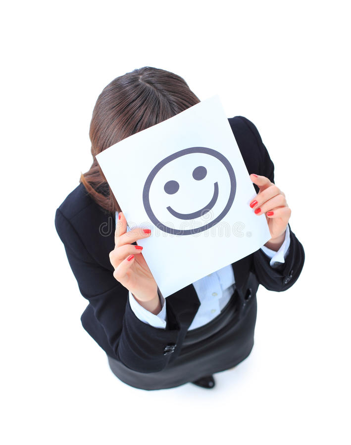 jeune femme d'affaires se cachant derrière un visage souriant photos stock