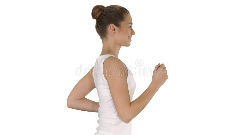 Jeune femme d'ajustement courant sur le fond blanc photo libre de droits