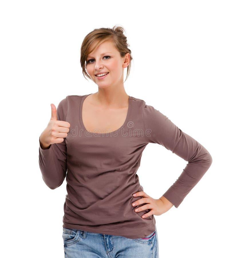 Jeune femme montrant le signe correct d'isolement sur le fond blanc photographie stock