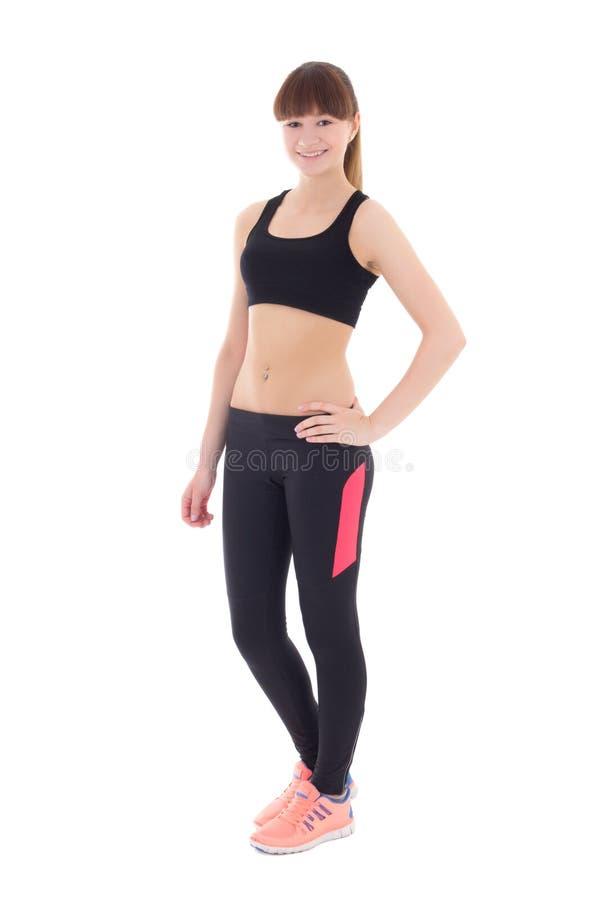 Jeune femme dans l'usage de sports d'isolement sur le blanc photographie stock