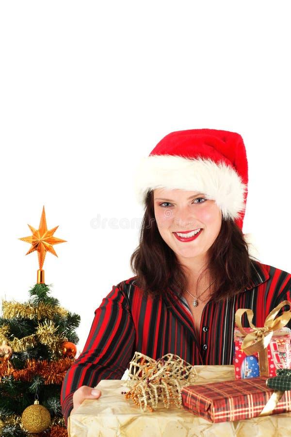 Jeune femme dans le capuchon et les présents de Santa photo libre de droits