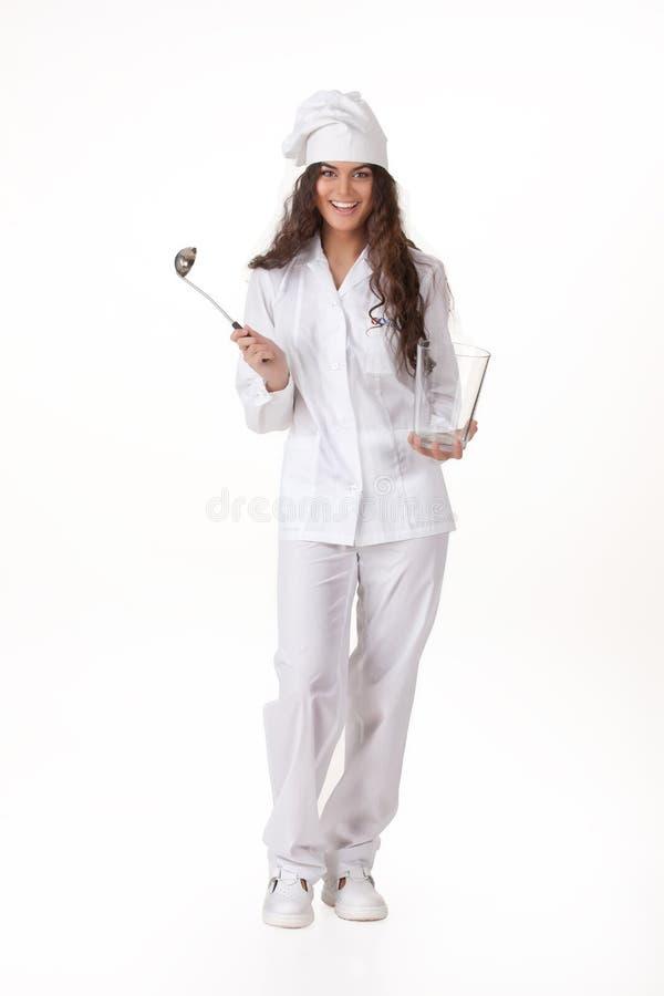 Jeune femme dans le cuisinier Uniform photographie stock