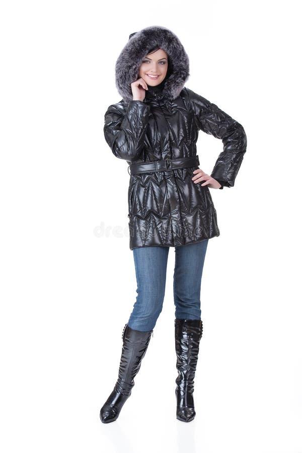 Jeune femme dans le vêtement à la mode photo stock