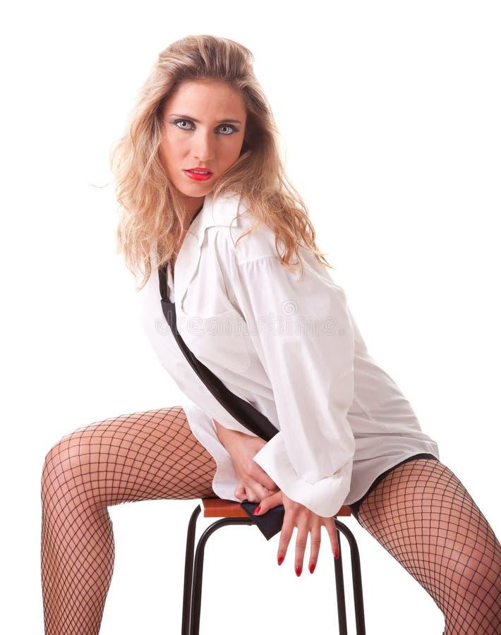 jeune femme dans une chemise d 39 homme blanc photo stock image du pose caucasien 22052702. Black Bedroom Furniture Sets. Home Design Ideas